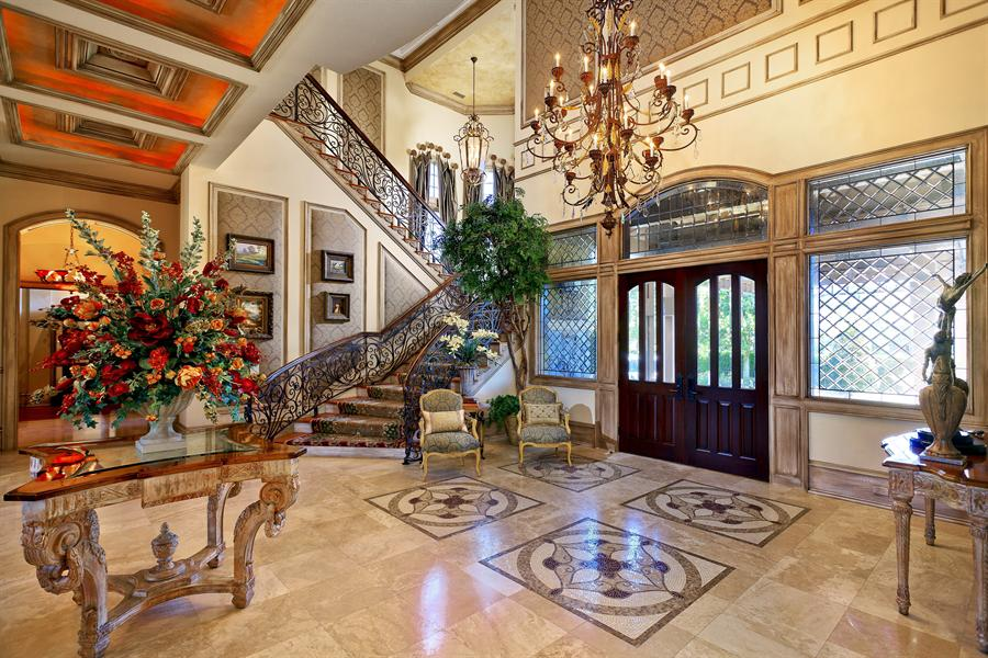 A Spectacular Fireplace And Wall Of French Doors With Commanding Views The Pool Define Formal Living Room Dining Has Double Sided