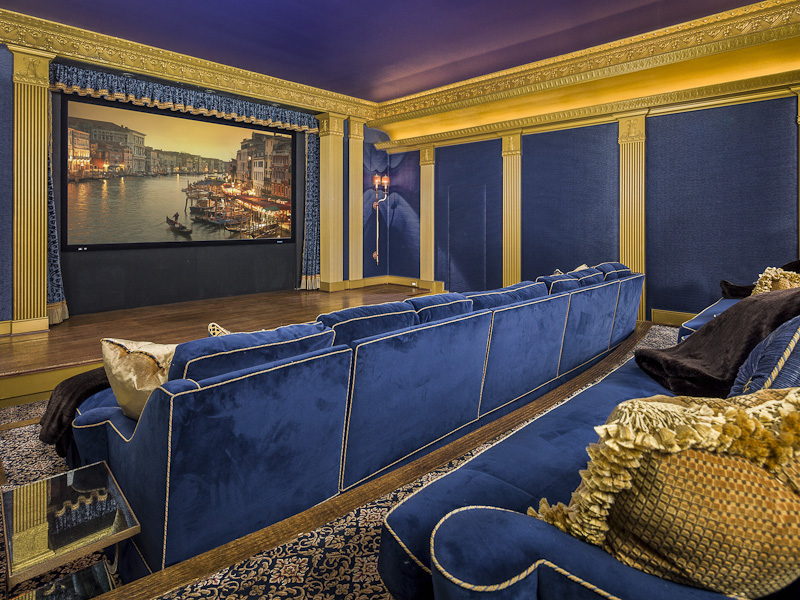 evoking the golden age of cinema with lush blue velvet seating
